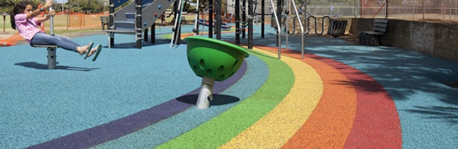 Softurf brand poured-in-place rubber matting is excellent for safety surfacing and comes in attractive colors and styles. [Photo: Rainbow Design at Waialae Iki Park]